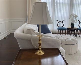 Brass Candlestick lamp with white shade and finial.
