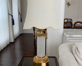 Exquisite brass and glass table lamp with cream textured shade and crystal finial.