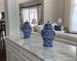 Collection of blue and white Chinoiserie urns, plates, candlesticks and others.