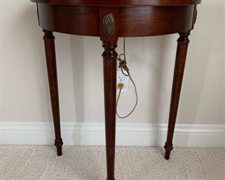 Demi Lune table, brass hardware.