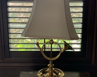 """""""Hunting Horn"""" brass table lamp, cream shade with finial."""
