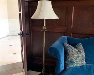 Floor lamp, brass, round base with cream shade and finial.