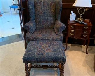 Armchair and ottoman, upholstered in blue tapestry fabric.