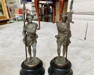 Spelter figures of cavaliers on heavy black base.