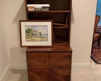 Bookshelf with base drawers.
