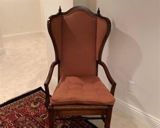 Arm chair, upholstered in rust-colored fabric, rush seat.