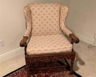 Arm chair, heavily carved apron, upholstered in cream floral fabric.