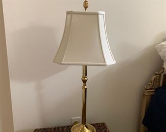 Table lamp, brass with cream shade and finial.