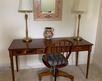 Desk, three drawer.  Pair of brass table lamps, office chair on casters.