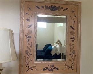 Floral wall mirror.