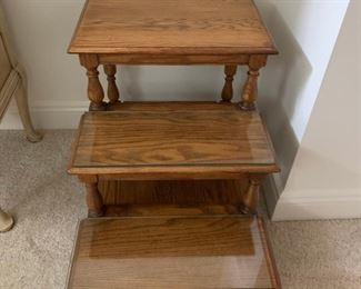 Decorative step display unit with glass top.