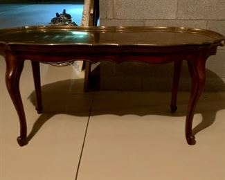 Table with removable brass tray top.