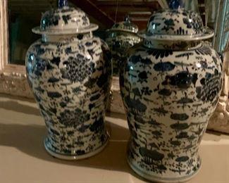 Blue & white Chinoiserie vases, foo dog finials.