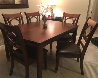 Outstanding dining room table with 6 chairs and an extension with custom made protection pads
