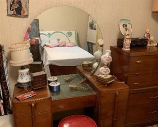 Dressing table with round mirror, twin quilt, lamps, and much more
