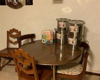 Round formula table, 2 pairs of chairs and brand new stock pots!
