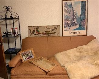 Metal and glass shelves, large overstuffed sofa. Fur rug or throw, electric heater and lots of picture!