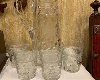 Beautiful cut glass water pitcher and cut glass glasses.