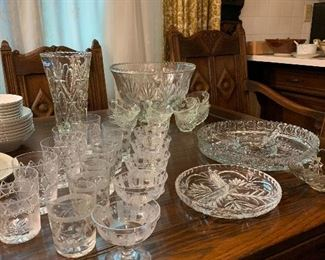 Beautiful cut glass high balls and champagne glasses, punch bowl with 8 cups and various beautiful cut glass serving pieces