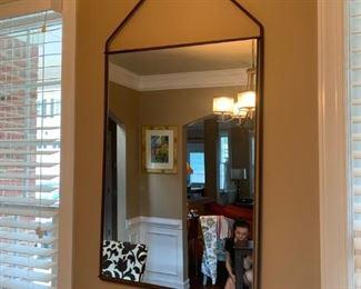 Simple, elegant wall mirror.