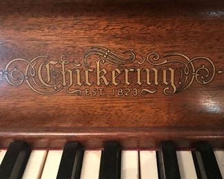 Logo on vintage upright Chickering piano