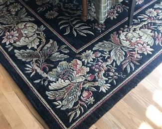 Large area rug under dining room table