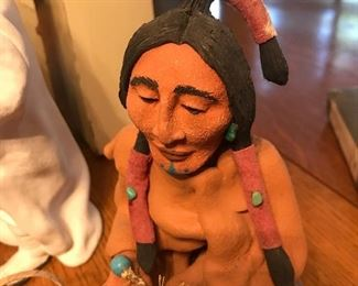 up close of one of the Native Americans bearing gifts in the Native American Nativity