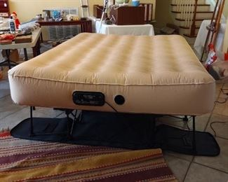 """Frontgate E Z Bed Sleep and Save - self inflates and deflates. All compact on it's own bed frame, folds down into its own """"luggage on wheels"""" for easy storage"""