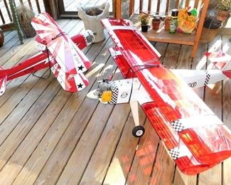 Both of these model airplanes have engines and have been flown several times. Each works off a remote, which I do not have. Each one is huge!