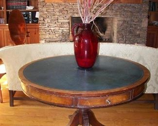 leather top game table and large red glass jar