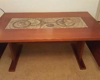 Teak and tile drop leaf dining table.