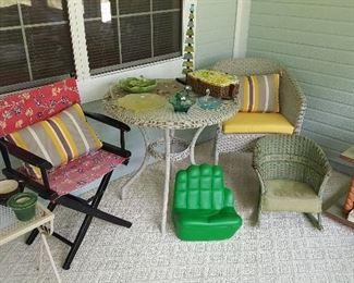 More outside and sunroom furniture. Antique child's wicker rocker.