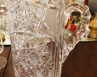 One of two brilliant cut glass pitchers