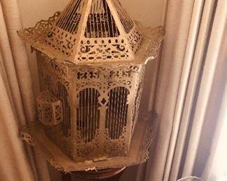 A vintage brass birdcage from a forgotten era