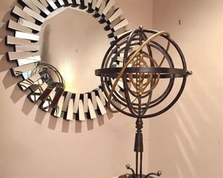 Wall mirror and armillary sphere