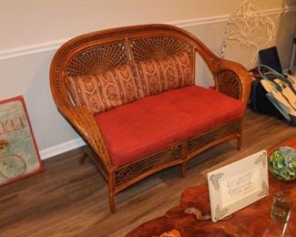 Woven wicker loveseat w/ cushion and 2 pillows