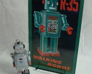 THE SILVER TIN WALKING ROBOT