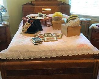 Queen deco bed littered with vintage pill-box hats and sundry
