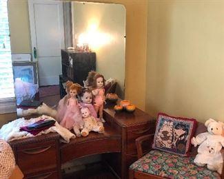 antique vanity. Small army of antique creepy dolls