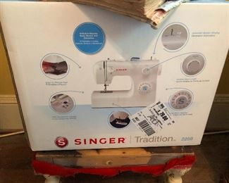 Singer sewing machine still in box. Learn a skill! It helps to be useful in the apocalypse