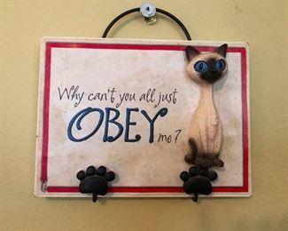 Siamese cat making predictable demand