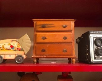 vertical caskets for beloved muskrats. Vintage camera. Chitty chitty bang bang