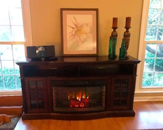 I'm back! I had two glasses of wine, immediately fell asleep and it's the next morning. Flat Screen TV Stand/ Fireplace of the nice fake variety