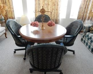 Contemporary round oak dinette & swivel chairs