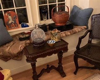 The living room window seat with great antiques! There is a Chinese lunch box and antique Chinese box, also the largest Baccarat Swirl vase plus much more!!