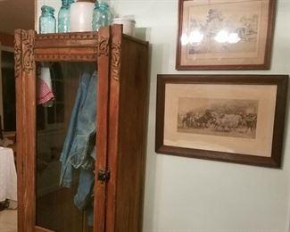 Oak leaf cabinet, stoneware jug, horsey prints