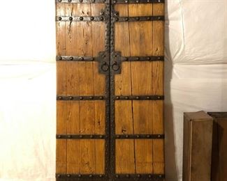 """Large gothic antique doors.  2 pieces.  These are hang-able using custom made iron bar on the back.  7' tall, approx 18"""" wide (each)."""