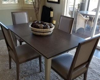 Crate and Barrel Dining table!  Comes with 3 leaves that store underneath the table itself.  4 chairs