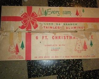 A six-foot aluminum Christmas tree with  box