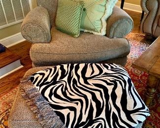 Custom upholstered club chair and ottoman